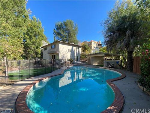 Photo of 21750 Ybarra Road, Woodland Hills, CA 91364 (MLS # OC20243718)