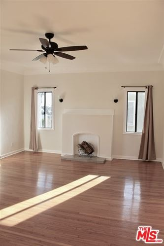 Photo of 1239 S Hudson Avenue, Los Angeles, CA 90019 (MLS # 21684722)