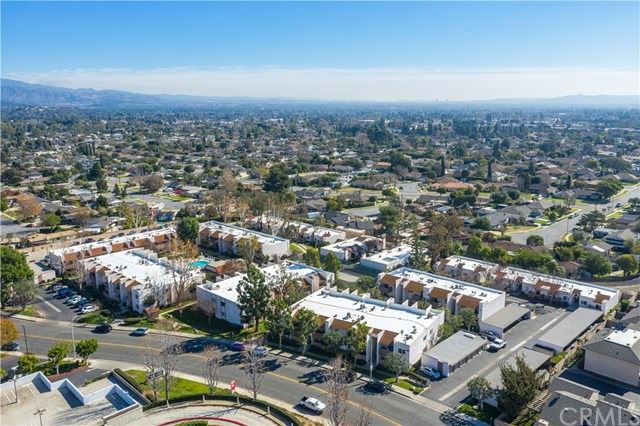 Photo of 17532 Vandenberg Lane #03, Tustin, CA 92780 (MLS # PW21090726)