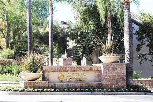 Photo of 24115 Del Monte Drive #73, Valencia, CA 91355 (MLS # OC20249738)