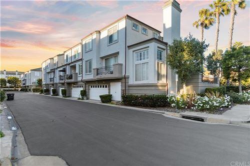 Photo of 19457 Surf Drive, Huntington Beach, CA 92648 (MLS # OC21201742)