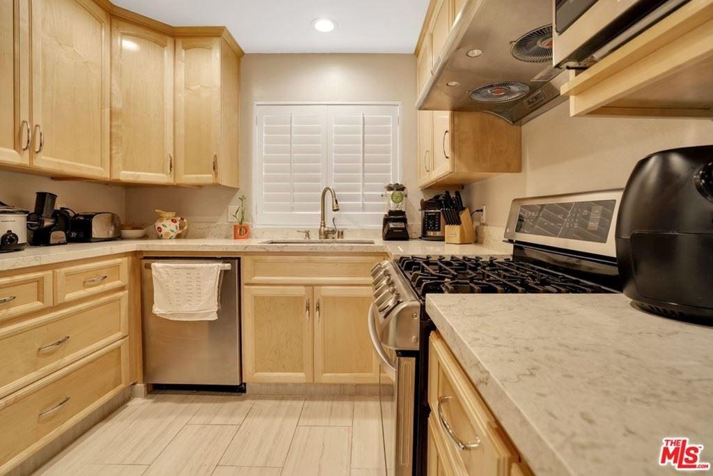 Photo of 10636 Woodley Avenue #13, Granada Hills, CA 91344 (MLS # 21750746)