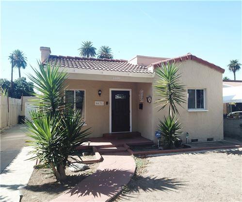 Photo of 6631 Olive Avenue, Long Beach, CA 90805 (MLS # CV21232758)
