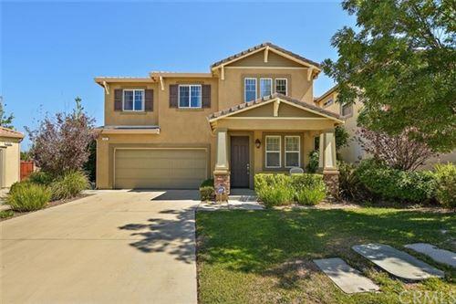 Photo of 511 Garden Avenue, Pomona, CA 91767 (MLS # CV20130760)