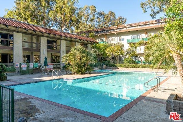 Photo of 5460 White Oak Avenue #F203, Encino, CA 91316 (MLS # 21723760)