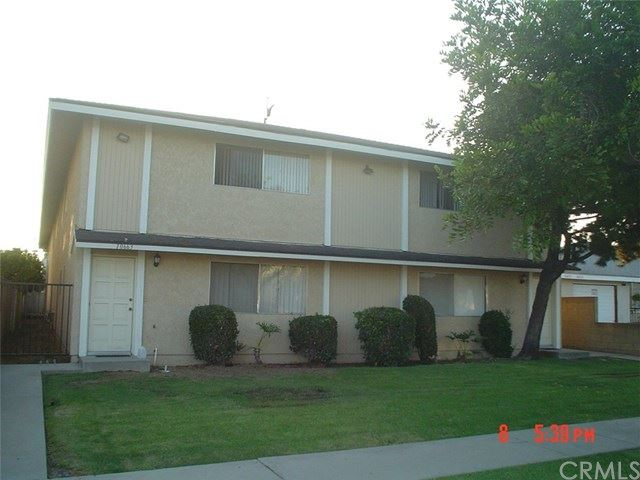 Photo of 10661 Walnut Street, Los Alamitos, CA 90720 (MLS # RS21022778)