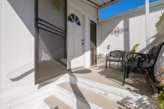 Photo of 23301 Ridge Route Drive #91, Laguna Hills, CA 92653 (MLS # OC21027780)