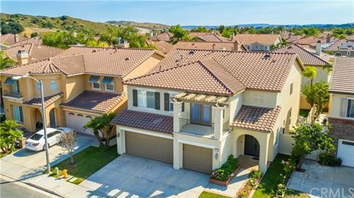 Photo of 27 Arbor Walk Lane, Rancho Santa Margarita, CA 92688 (MLS # OC20112784)