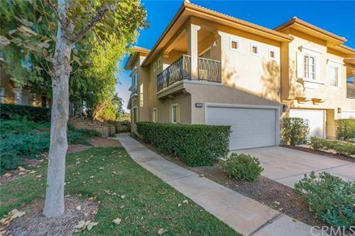 Photo of 27954 Dickason Drive, Valencia, CA 91354 (MLS # OC20247786)