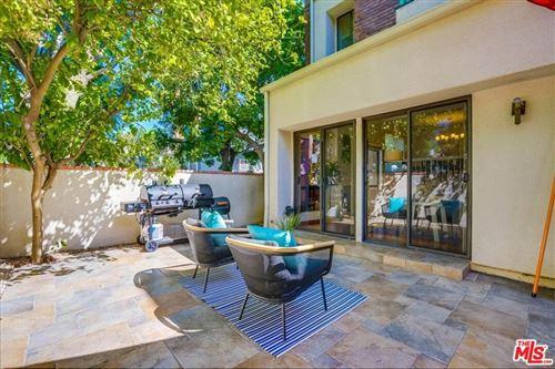Photo of 18731 Hatteras Street #31, Tarzana, CA 91356 (MLS # 21782788)