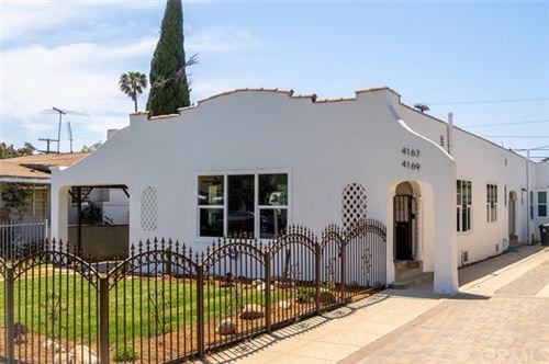 Photo of 4167 Denker Avenue, Los Angeles, CA 90062 (MLS # CV21096792)