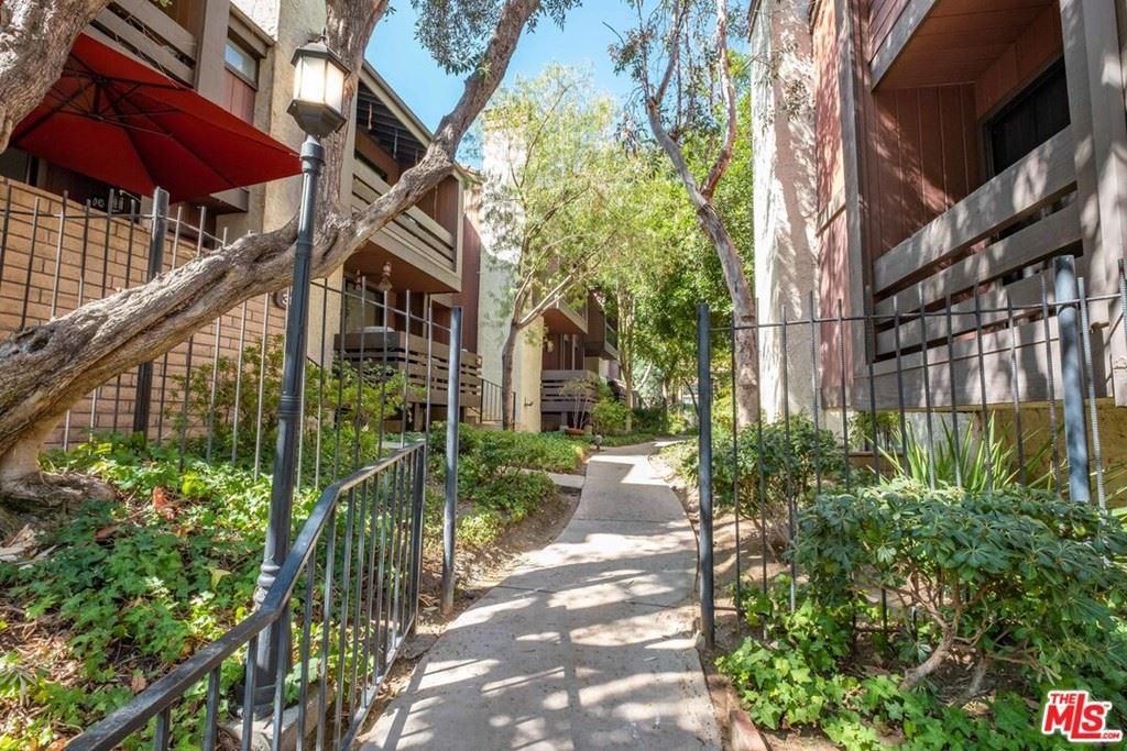 Photo of 21931 Burbank Boulevard #38, Woodland Hills, CA 91367 (MLS # 21785796)
