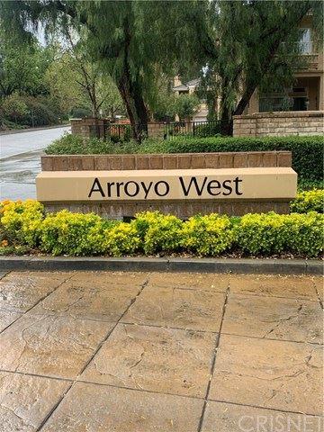 Photo of 24007 Arroyo Park Drive #64, Valencia, CA 91355 (MLS # SR20153797)
