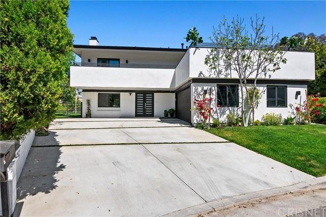 Photo of 22623 Cavalier Street, Woodland Hills, CA 91364 (MLS # SR21074807)