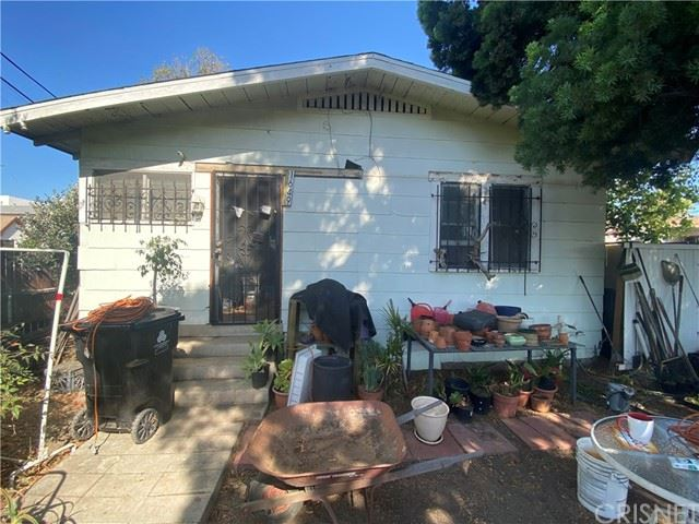 1649 S Rimpau Boulevard, Los Angeles, CA 90019 - #: SR21141808