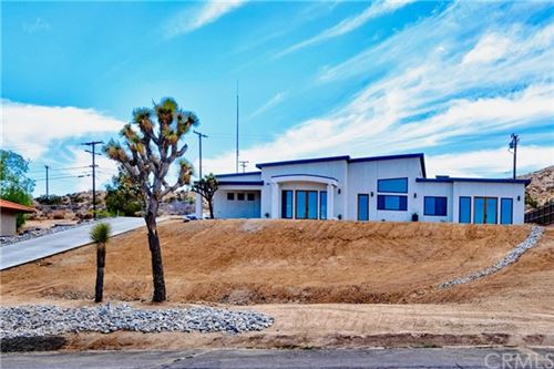 Photo of 7664 Shafter Avenue, Yucca Valley, CA 92284 (MLS # JT21102809)