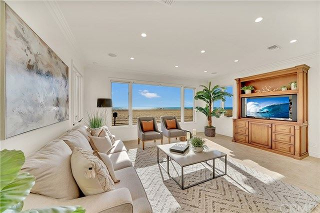 Photo of 3407 W Oceanfront, Newport Beach, CA 92663 (MLS # OC21056815)
