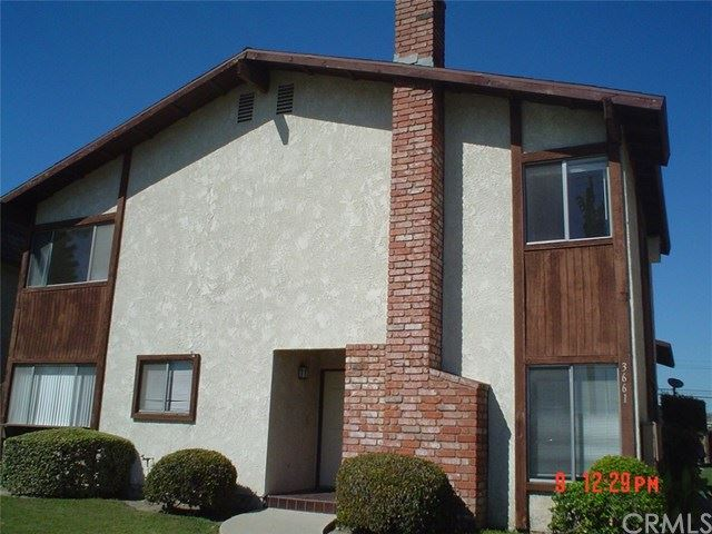 Photo of 3661 Farquhar Avenue, Los Alamitos, CA 90720 (MLS # RS21050818)