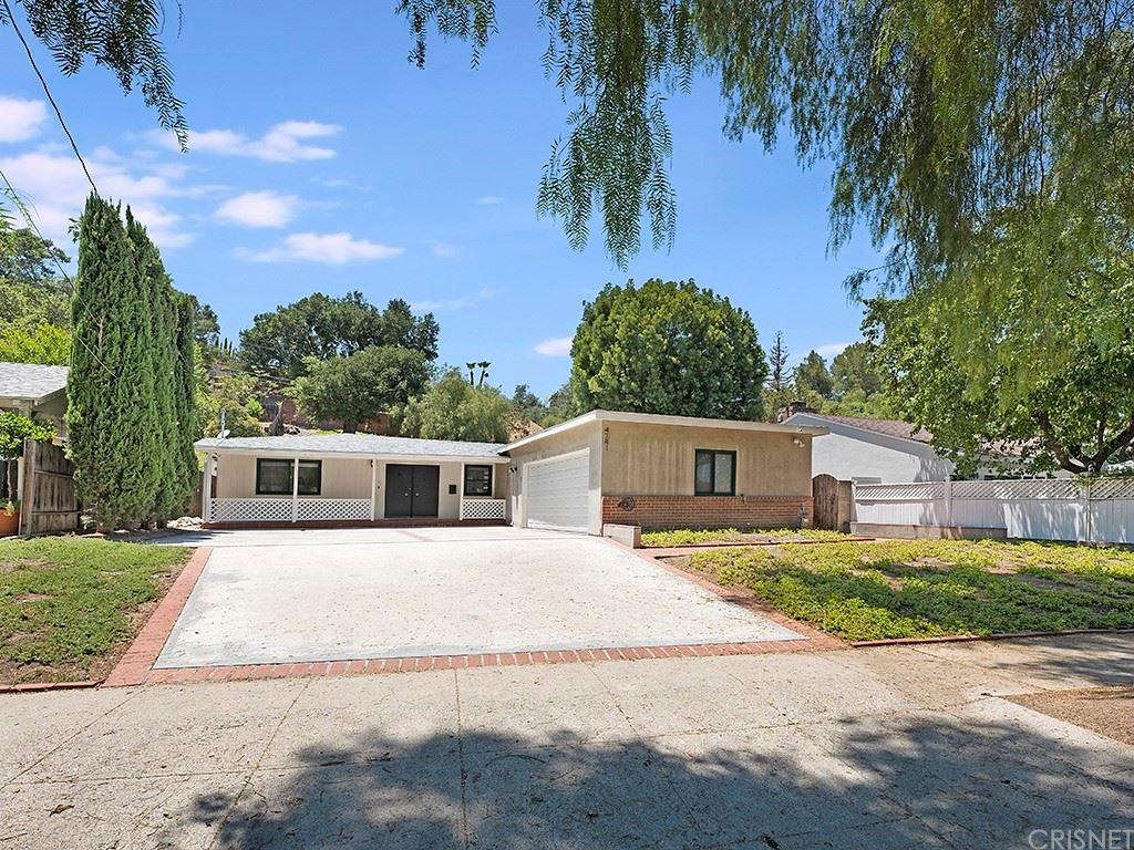 Photo of 4741 San Feliciano Drive, Woodland Hills, CA 91364 (MLS # SR21130824)