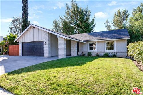 Photo of 16530 Fairglade Street, Santa Clarita, CA 91387 (MLS # 21797826)