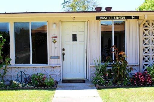 Photo of 13751 Saint Andrews Drive #34K, Seal Beach, CA 90740 (MLS # SW21129829)