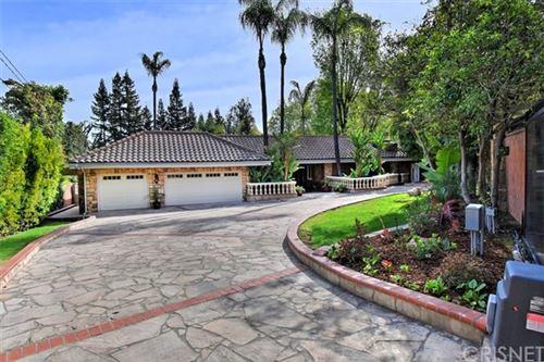 Photo of 4650 Caritina Drive, Tarzana, CA 91356 (MLS # SR21023841)