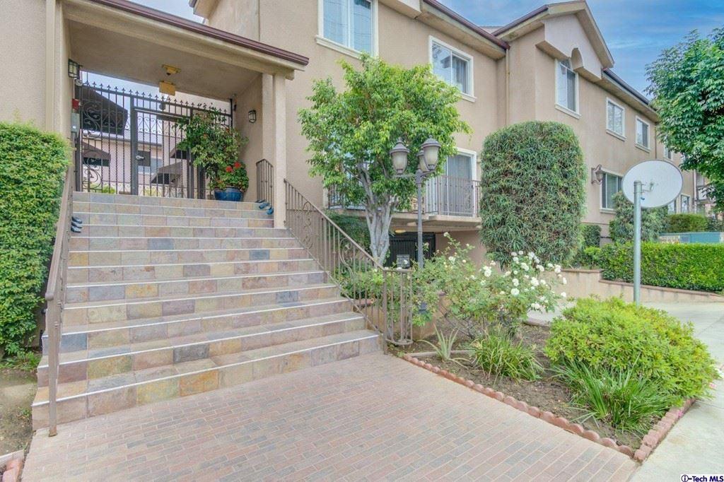 Photo of 6525 Woodman Avenue #9, Valley Glen, CA 91401 (MLS # 320007841)