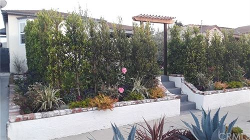 Photo of 1242 W 109th Place, Los Angeles, CA 90044 (MLS # DW21100843)