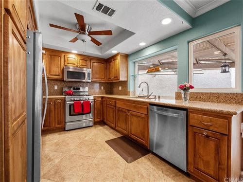 Photo of 2993 N Cottonwood Street #13, Orange, CA 92865 (MLS # OC21217846)