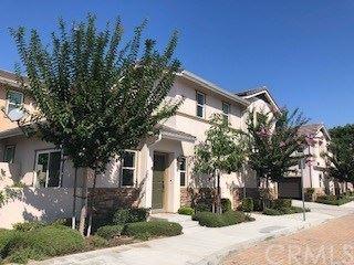 Photo of 9021 Meredith Way #E, Cypress, CA 90630 (MLS # OC20127863)