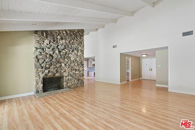 Photo of 5901 Lockhurst Drive, Woodland Hills, CA 91367 (MLS # 21735868)