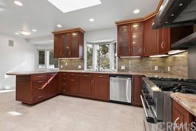 Photo of 16741 Knollwood Drive, Granada Hills, CA 91344 (MLS # SW20143872)