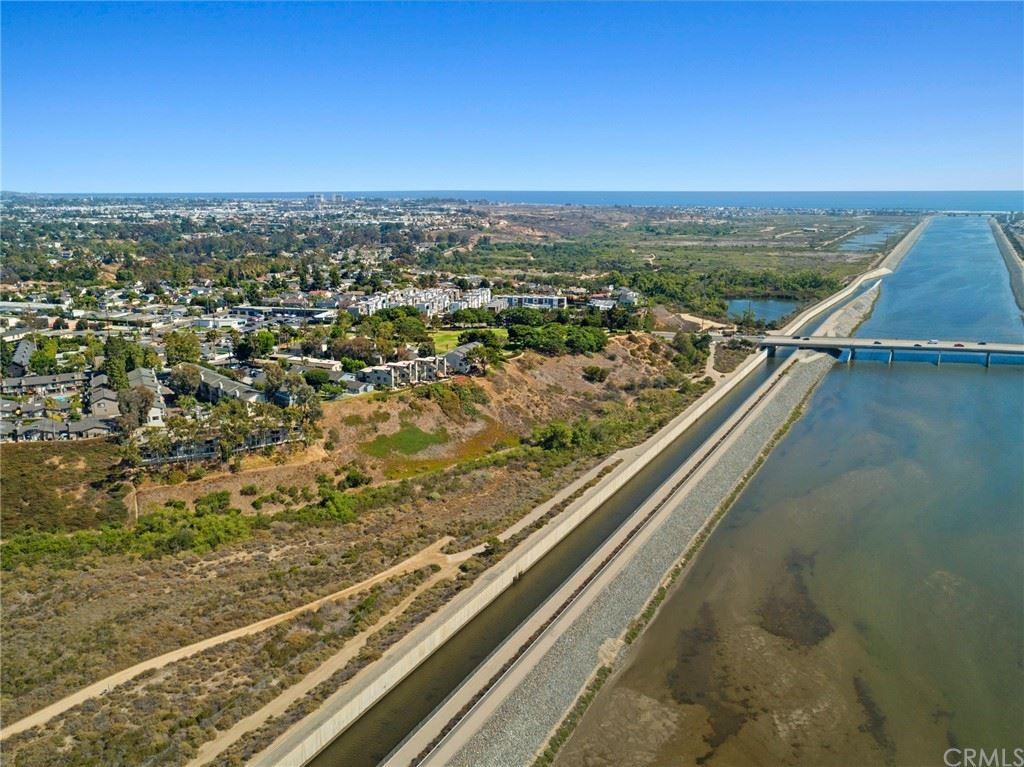 Photo of 1207 Las Arenas Way #4, Costa Mesa, CA 92627 (MLS # OC21159882)