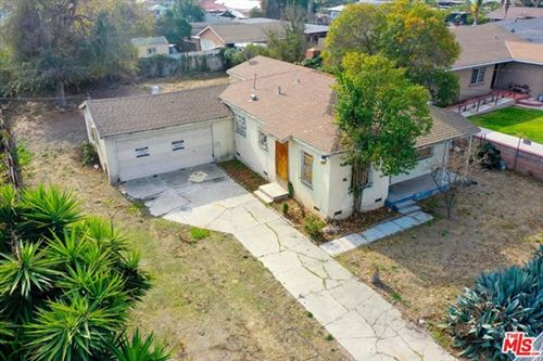 Photo of 404 W Bennett Street, Compton, CA 90220 (MLS # 21683894)