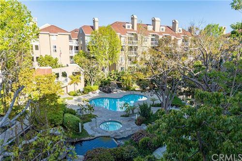 Photo of 20341 Bluffside Circle #301, Huntington Beach, CA 92646 (MLS # OC21073899)