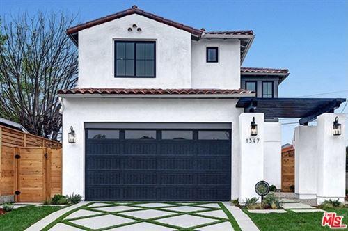 Photo of 1347 S Tremaine Avenue, Los Angeles, CA 90019 (MLS # 21694930)