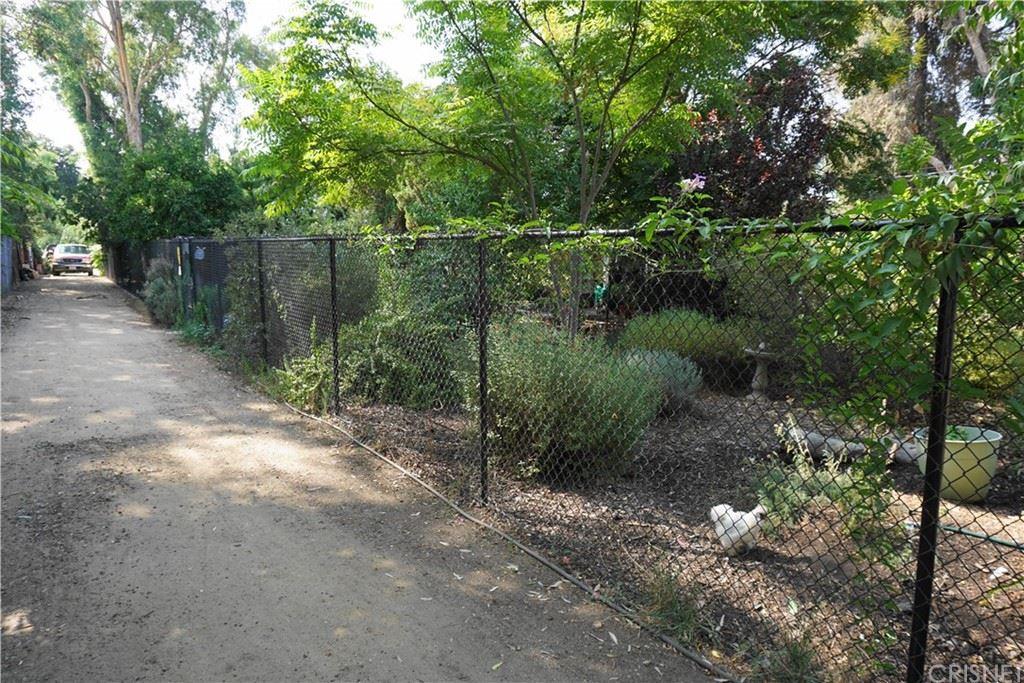 Photo of 5929 Melvin Avenue, Tarzana, CA 91356 (MLS # SR21193930)
