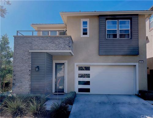 Photo of 106 Swift, Irvine, CA 92618 (MLS # OC21230932)