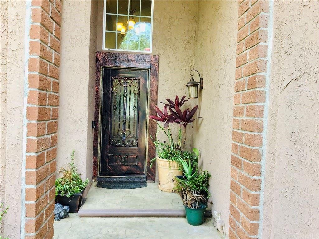Photo of 18718 Rochelle Avenue, Cerritos, CA 90703 (MLS # OC21157934)