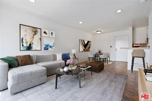 Photo of 525 S Ardmore Avenue #301, Los Angeles, CA 90020 (MLS # 21718936)