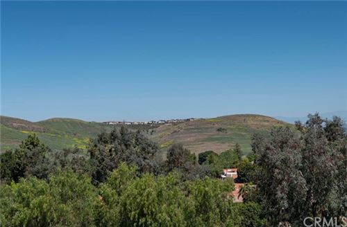 Photo of 24055 Paseo del Lago #207, Laguna Woods, CA 92637 (MLS # OC21083963)
