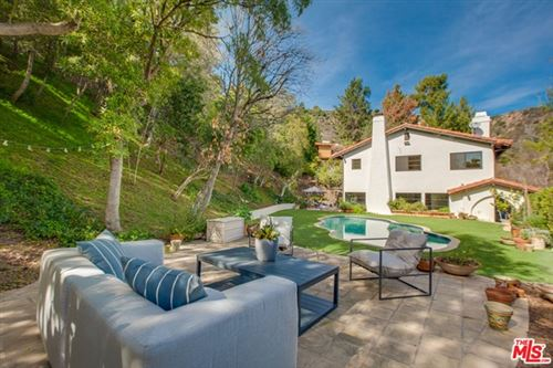 Photo of 1663 Stone Canyon Road, Los Angeles, CA 90077 (MLS # 21696970)