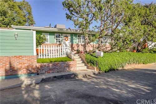 Photo of 5050 Calatrana Drive, Woodland Hills, CA 91364 (MLS # OC20256971)