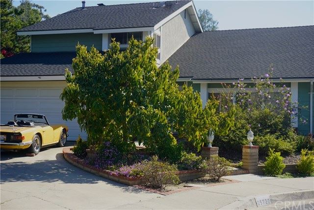 Photo of 25722 ORCHARD RIM LN, Lake Forest, CA 92630 (MLS # OC21045976)