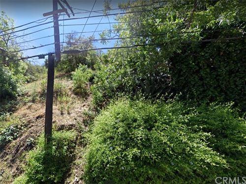 Photo of 1425 N Beverly Glen Boulevard, Los Angeles, CA 90077 (MLS # CV20216979)
