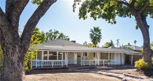 Photo of 525 Country Club Lane, San Bernardino, CA 92404 (MLS # CV20248980)