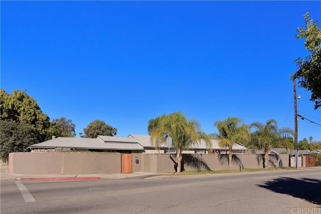 Photo of 5611 WOODLAKE Avenue, Woodland Hills, CA 91367 (MLS # SR20038061)