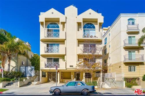 Photo of 11907 DARLINGTON Avenue #103, Los Angeles , CA 90049 (MLS # 19535136)