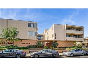 Photo of 5429 NEWCASTLE Avenue #108, Encino, CA 91316 (MLS # SR18247201)