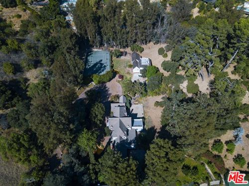 Photo of 9855 DEEP CANYON Place, Beverly Hills, CA 90210 (MLS # 19528206)